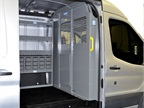 This interior view of the low roof Transit shows the partition and