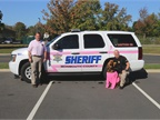 The Monmouth County Sheriff's Office in New Jersey painted pink stripes on one of its patrol vehickes, a K9 unit, and placed magnetic pink ribbons on the rest of its police cruisers. Even the agency's bloodhound, Skye, went pink for the unveiling. Photo courtesy of Monmouth County Sheriff's Office