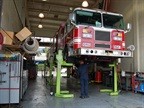 Sean Selff is pictured here working on one of the city s fire trucks.