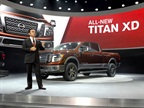Carlos Ghosn, president and CEO of Nissan Motor Co., presents the 2016 Nissan Titan XD at the North American International Auto Show.