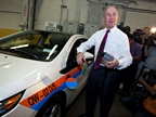 New York City Mayor Michael R. Bloomberg holds a power cord used to