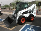 This is a Bobcat S770 Skid Steer Loader.
