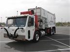 Crane Carrier Co. brought its low-entry tilt refuse truck (LET2).