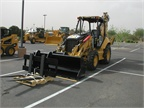 Pictured is a Caterpillar 420E IT Backhoe Loader.