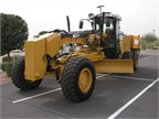 This is a Caterpillar 120M motor grader.