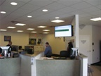 In the customer service area, the flatscreen shows the status of any