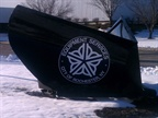 The Equipment Services department has its sign on a snow plow mounted