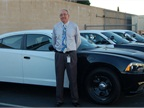 Ron Lindsey began his post as City of Anaheim fleet superintendent in February 2012. Here he stands with three new Dodge Chargers the City is testing out for its police fleet.