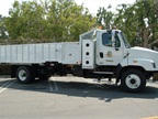 CNG-powered Freightliner SD114 with Ctec body stakebed dump truck from