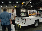 A representative of Roadline Trucks talks with an attendee.