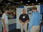 A representative from Discrete Wireless speaks with an attendee.
