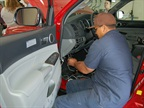 A fleet technician works on one of the city s new Toyota lifeguard