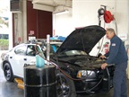Mike Przysiecki, equiment mechanic II, works on a police vehicle.
