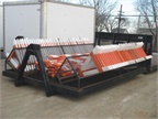 Hauling Barricades This custom hook lift bed from the City of Moline,