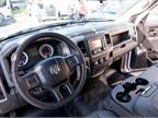 The spartan cab offers vinyl flooring and hand-crank windows.