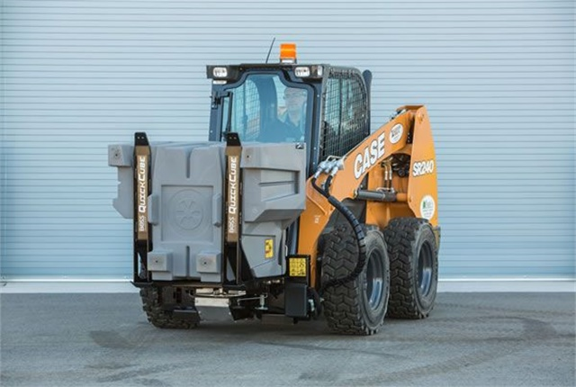 <p>The Quickcube is pictured with a skid steer loader. <em>Photo courtesy of Boss</em></p>