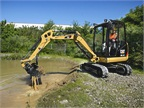 Cat 302.4D Mini Excavator cleaning a pond